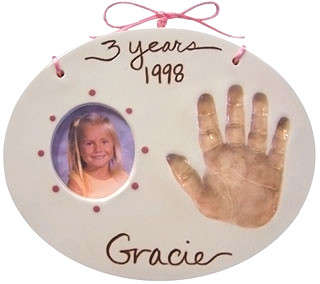 Ceramic child handprint shown with the photo frame option