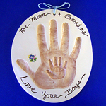 Hand-in-Hand - ceramic hand print of both parent and child captured in clay