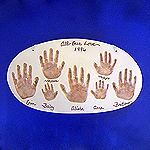 Generational - ceramic family handprints captured in clay